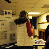 Jessica explains energy efficient bulbs to fans at a TMP high school basket
